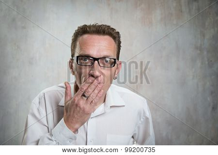 man close his mouth by hand. Concept of suppression