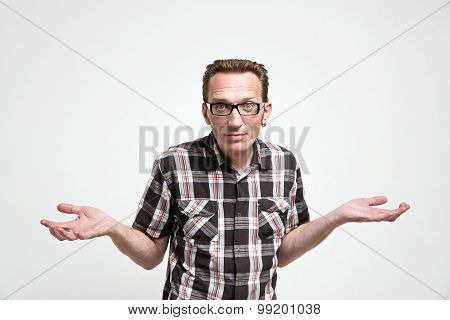 Man in casual clothes shrug his hands in amazement