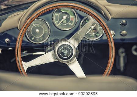 Sleza, Poland, August 15, 2015: Close Up On Porshe  Vintage Car Steering Wheel And Kockpit On  Motor