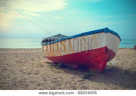 Deteriorated boat aground in the  beach
