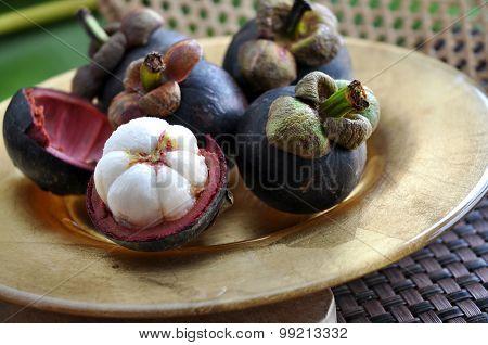 Mangosteen Fruit On Gloden Plate