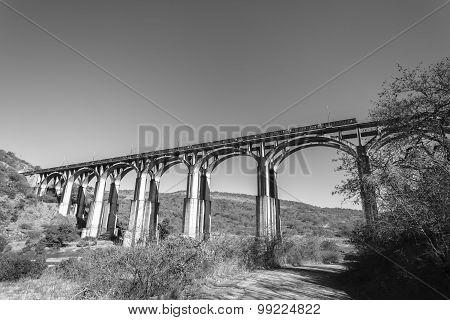 Bridge Train Rugged Landscape
