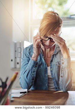 Concerned Female Entrepreneur Talking On A Phone