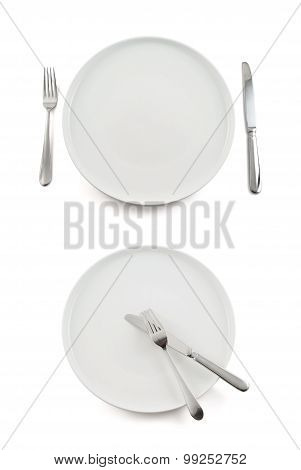 Table knife, fork and ceramic plate isolated