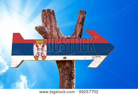 Serbia Flag wooden sign with sky background poster
