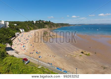 Beautiful weather and summer sunshine drew visitors to Tenby north beach South Wales