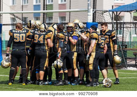 RUSSIA TROITSK CITY - JULY 11: Unidentified players of Spartans team just before Russian american football Championship game Spartans vs Raiders 52 on July 11 2015 in Moscow region Troitsk city Russia