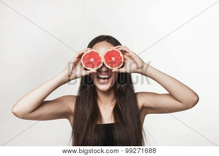 Funny Image Of Young Woman Holding Grapefruit