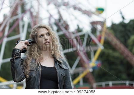 Rebellious Teenager Holding Gun