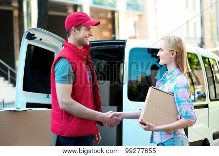 First class delivery service. Courier Delivering Package By Van.