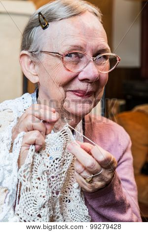 Smiling Elderly Woman With Crochet