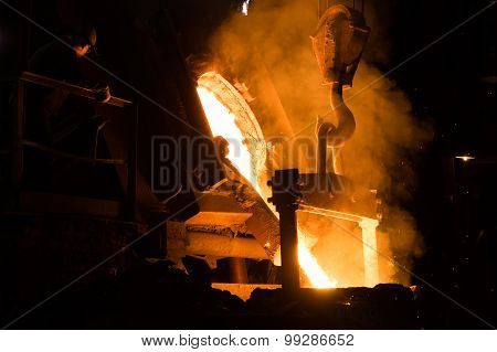Foundry Worker Watching Hot Liquid Metal Flow