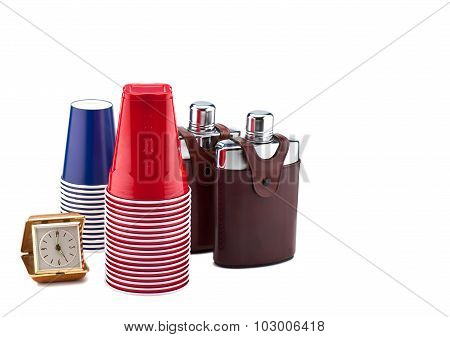 A clock, cups and flasks