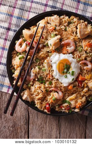Nasi Goreng With Chicken, Prawns, Egg And Vegetables Closeup Vertical Top View