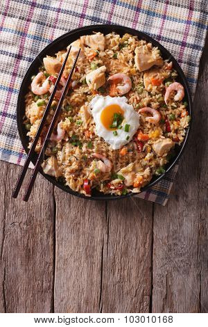 Nasi Goreng With Chicken, Prawns, Egg And Vegetables Vertical Top View