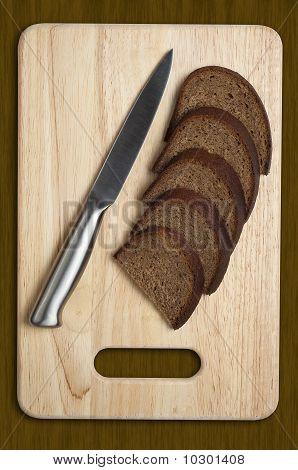 Metallic Knife And Sliced Bread