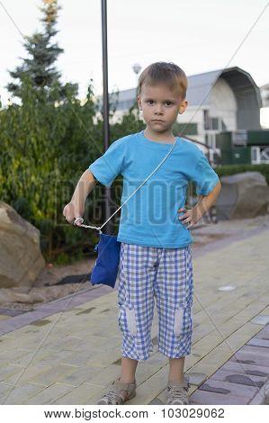The Little Boy On Walk.
