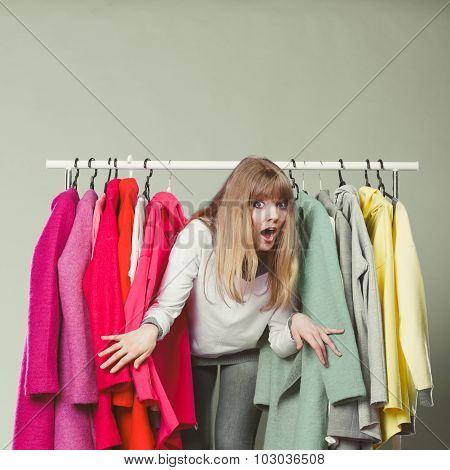 Woman Sneaking Among Clothes In Mall Or Wardrobe.