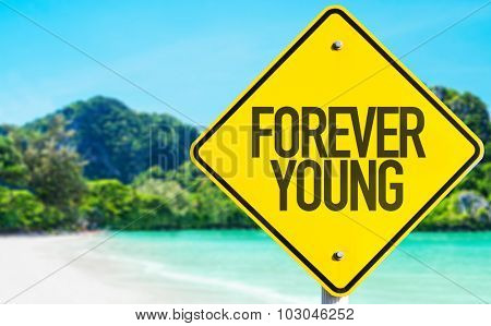 Forever Young sign with beach background