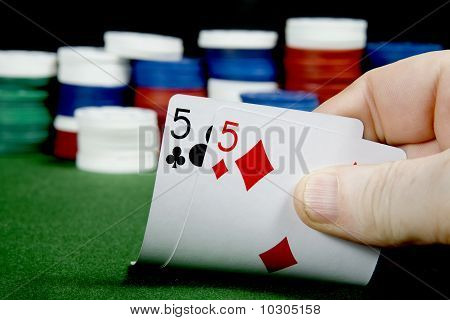A pair of fives at texas holdem Poker