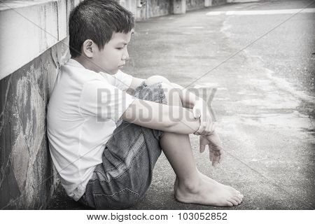Asian boy scared and alone