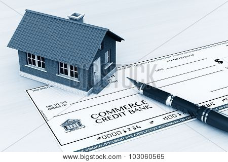 Bank Check With House And Pen