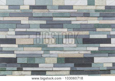 Grey black and white brick wall background