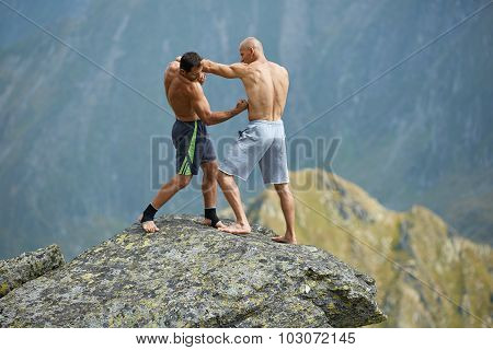 Kickboxers Or Muay Thai Fighters Training On A Mountain Cliff