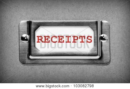 The word Receipts in red text on white card in a metal holder on a filing cabinet drawer. Processed in black and white for effect poster