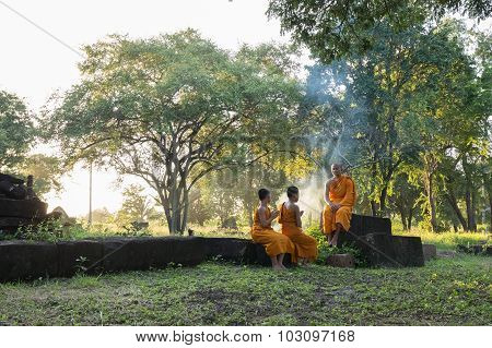 Nidentified Thai Monks In The Garden At Phanomwan Historical Park