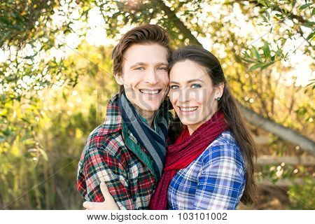 Happy young couple together outside