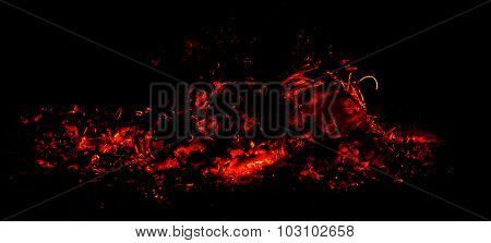 panorama the dying fire and hot red sparks on a black background