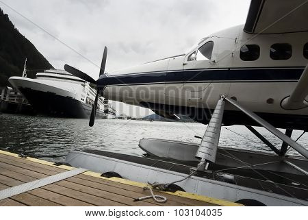 Seaplane and cruise ships docked along the pier in Juneau, Alaska
