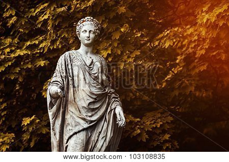 Marble statue of roman Ceres or greek Demeter in the park of the Palace and park complex Estate of G. Galagan. Sokyryntsi village, Ukraine. Toned photo