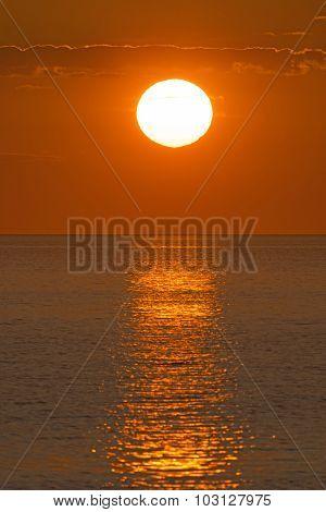 Sunset Reflections Over An Ocean Bay