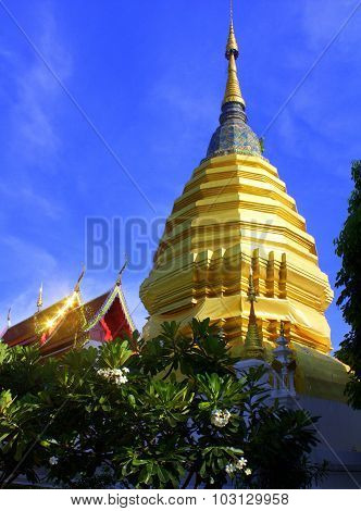 Golden stupa and gleaming temple