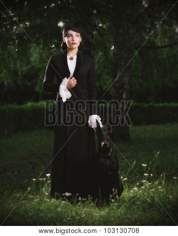 Young woman in ancient costume with dog (ancient version)