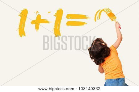 Little girl writing the right answer for math equation with painting brush
