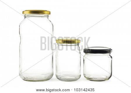 Three empty glass jars on white