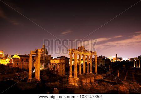 The Roman Forum, Italian Foro Romano in Rome, Italy at night. Ruins of Roman ancient city.