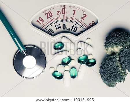 Broccoli Stethoscope Pills On Weight Scale. Dieting