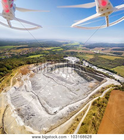 Aerial view to opencast mine. Use drones to inspect of mining area. Modern technology theme.