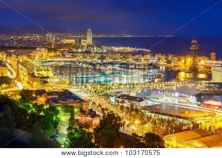 Aerial view over Port Vell marina, Passeig de Colom, Barceloneta and Rambla de Mar at night in Barcelona, Catalonia, Spain poster