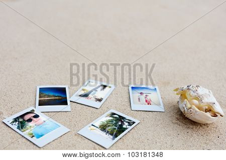 Vacation memories seashell and instant snapshot photos on tropical sandy beach