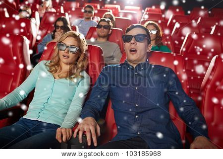 cinema, technology, entertainment and people concept - scared friends or couple with 3d glasses watching horror or thriller movie in theater with snowflakes