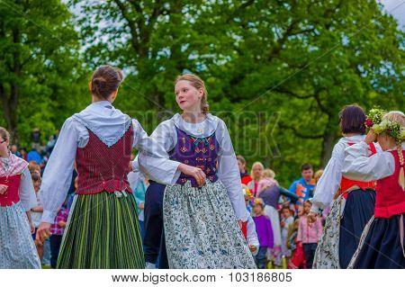 Dancing Around The Maypole In Midsummer, Gothemburg, Sweden