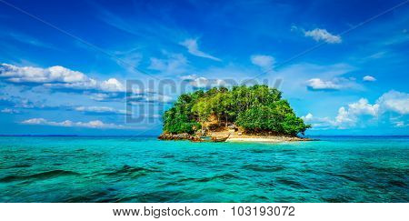 Panorama of tropical island and long-tail boat in sea. Thailand