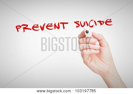 The word prevent suicide against female hand holding black whiteboard marker