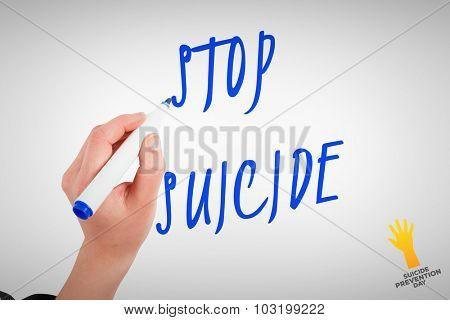 Businesswomans hand writing with marker against suicide prevention day