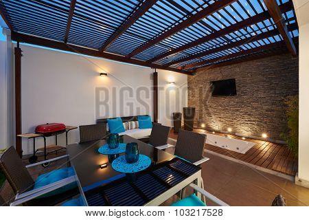 Interior design: Beautiful modern terrace lounge with pergola at sunset